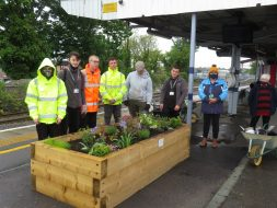 Planter at Sittingbourne Station with Sheppey College Students